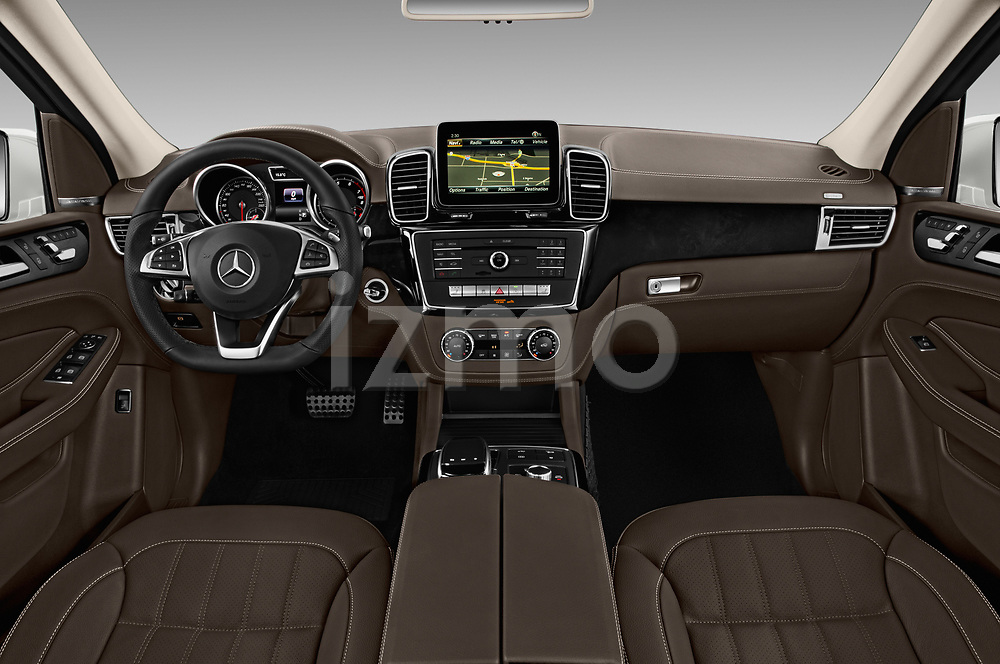 Stock photo of straight dashboard view of 2018 Mercedes Benz GLE AMG-43 5 Door SUV Dashboard