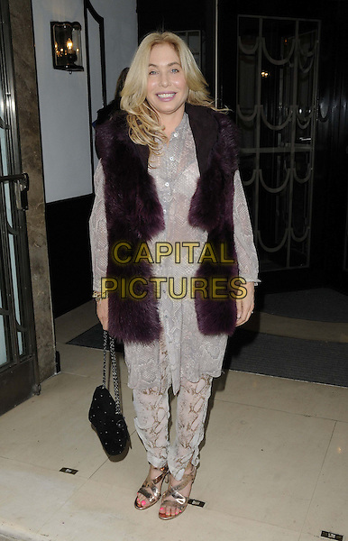 Brix Smith-Start.The Very.co.uk s/s 2013 catwalk show, Claridge's Hotel, Brook St., London, England..September 13th, 2012.full length purple fur long gilet sleeveless jacket grey gray lace shirt top trousers black bag purse .CAP/CAN.©Can Nguyen/Capital Pictures.