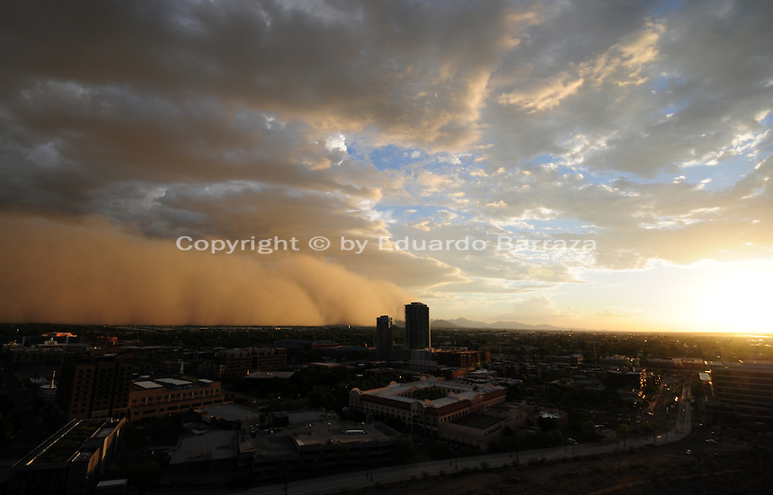 "Phoenix, Arizona (September 6, 2014) -- The fast moving dust wall moves into the Phoenix area from the southeast side of the Valley in a northwest direction. A massive dust storm sweeps into the Phoenix metropolitan area blanketing the Valley. The phenomenon created a massive wall of dust, also called ""baboob"". The dust storm was followed by thunderstorms producing very heavy rain.  Photo by Eduardo Barraza © 2014"