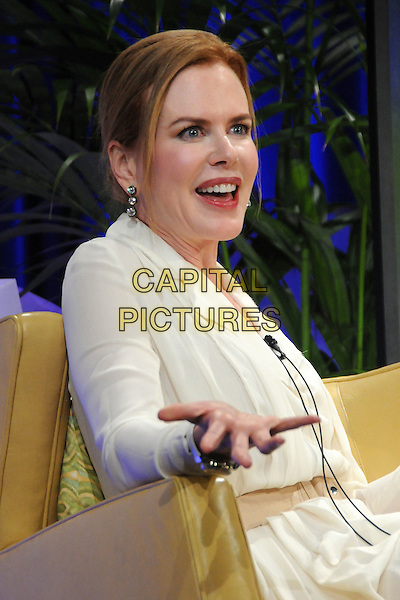 NICOLE KIDMAN .2011 Santa Barbara International Film Festival - Cinema Vanguard Award Presented to Nicole Kidman held at the Arlington Theater,  Santa Barbara, California, USA, .5th February 2011..half length dress white cream shirt sitting down chair smiling hand gesture .CAP/ADM/BP.©Byron Purvis/AdMedia/Capital Pictures.
