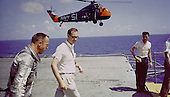 Atlantic Ocean - (FILE) -- Astronaut Alan B. Shepard is seen on the deck of the U.S.S. Lake Champlain after the recovery of his Freedom 7 Mercury space capsule following his sub-orbital flight on Friday, May 5, 1961 where he became the first American in space..Credit: NASA via CNP