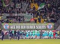 Wolfsburger Fans feiern den Auswärtssieg ihrer Mannschaft trotz blauen Trikots - 23.11.2019: Eintracht Frankfurt vs. VfL Wolfsburg, Commerzbank Arena, 12. Spieltag<br /> DISCLAIMER: DFL regulations prohibit any use of photographs as image sequences and/or quasi-video.