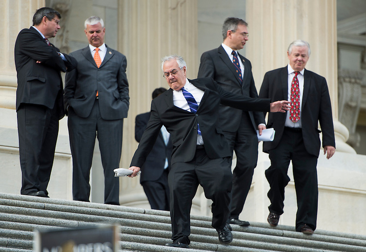 UNITED STATES - DECEMBER 5: Rep. Barney Frank, D-Mass., slips on the House steps as member of Congress adjourn early following their last vote of the week on Wednesday, Dec. 5, 2012. (Photo By Bill Clark/CQ Roll Call)