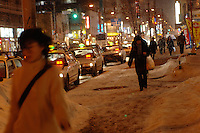 People walking on the street under cold weather in Sapporo, Hokkaido, Japan..Feb 2008