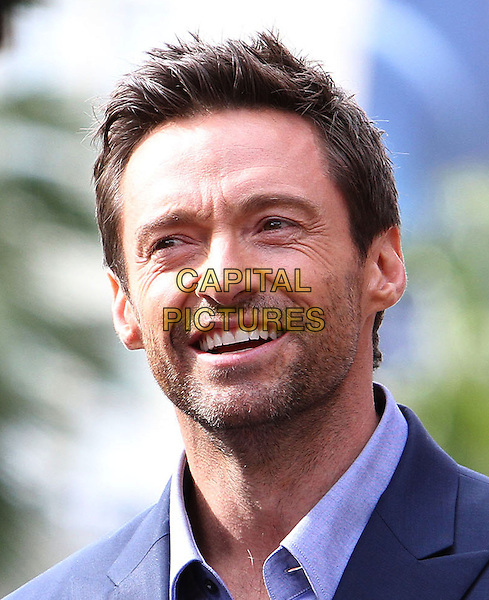 Hugh Jackman.Hugh Jackman is honoured with a Hollywood Star Held on the Hollywood Walk of Fame, Hollywood, California, USA, 13th December 2012..portrait headshot beard facial hair stubble navy blue suit shirt smiling .CAP/ADM/KB.©Kevan Brooks/AdMedia/Capital Pictures.