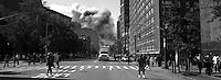 A few moments after both towers colapsed seen from 6th Ave.  New York September 11, 2001