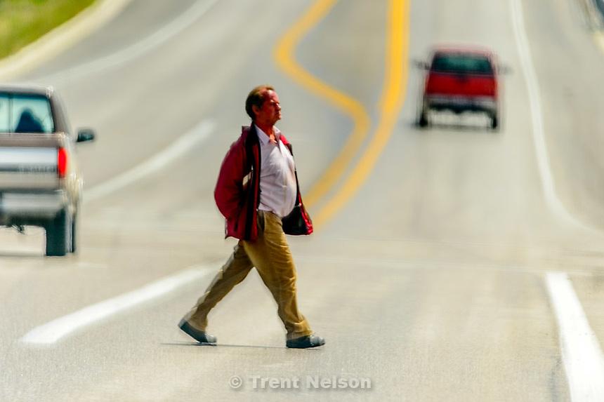 man crossing street, Monday May 25, 2015.
