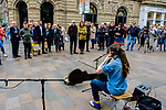 Paisley born cellist/singer/songwriter CALUM INGRAM playing cello in Buchanan Street Glasgow while being filmed for a documentary. Record Producer Tony Visconti (Mark Bolan, Thin Lizzy, Morrisey, David Bowie) looks on (C - dark glasses).<br /> <br /> (c) Andrew Wilson | Edinburgh Elite media