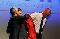 US Soccer President Sunil Gulati and Claudio Reyna help Hall of Fame inductee Earnie Stewart put on the red jacket during the 2011 National Soccer Hall of Fame induction ceremony in Foxborough, MA, on June 04, 2011.