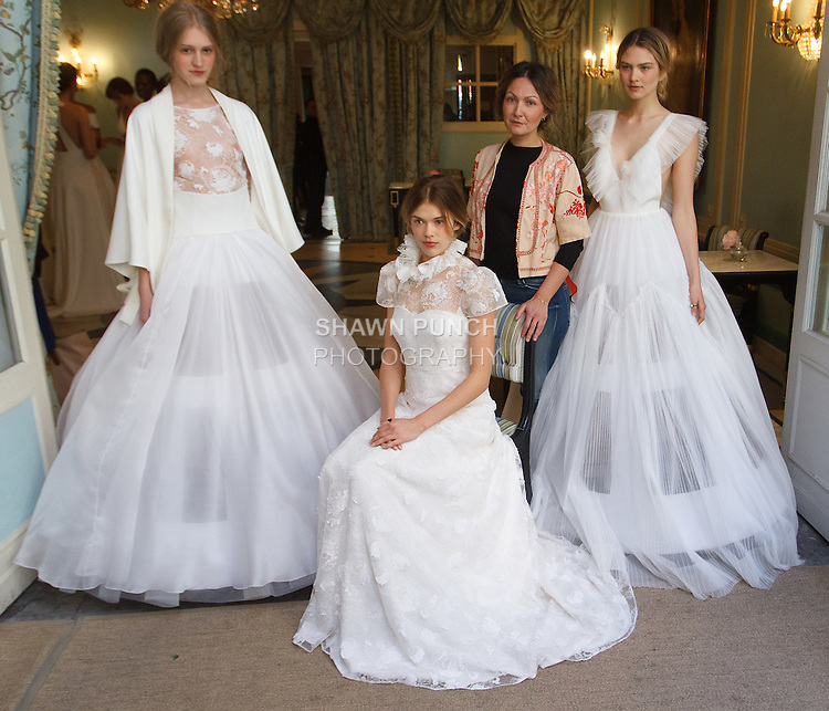 Fashion designer Delphine Manivet poses with models in bridal gowns during her Delphine Manivet Spring Summer 2017 Bridal collection fashion presentation, at Ladurée SoHo at 76 Thompson Street, during New York Bridal Fashion Week Spring Summer 2017, on April 18, 2016.