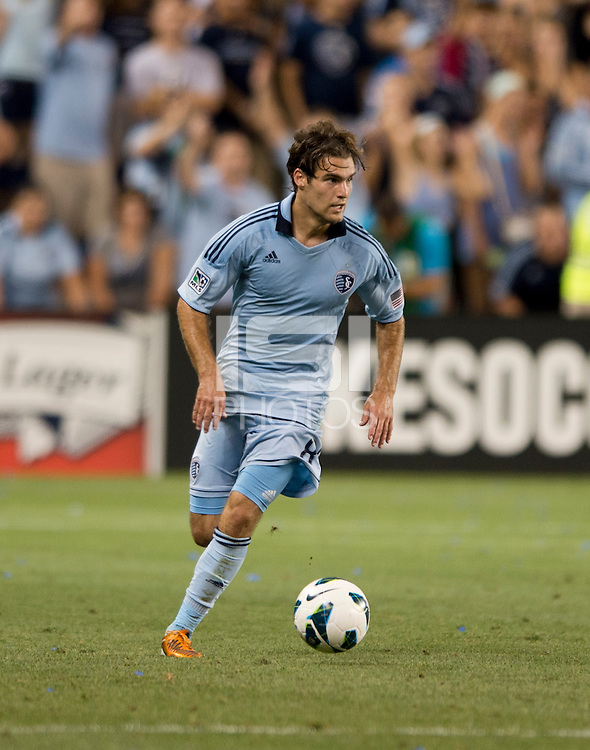 Graham Zusi. Sporting Kansas City won the Lamar Hunt U.S. Open Cup on penalty kicks after tying the Seattle Sounders in overtime at Livestrong Sporting Park in Kansas City, Kansas.