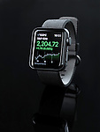 Apple Watch smartwatch with stock market app on display isolated on black background
