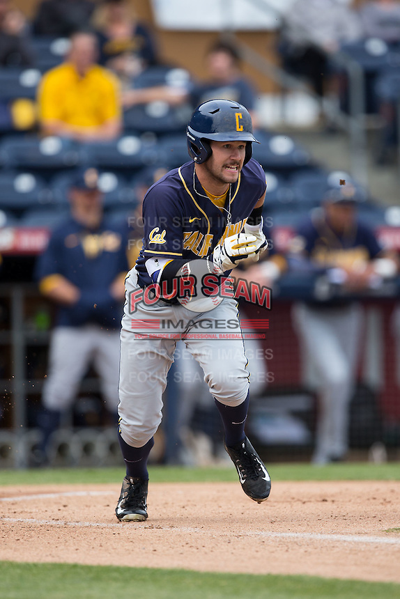 Aaron Knapp (23) of the California Golden Bears hustles down the first base line against the Duke Blue Devils at Durham Bulls Athletic Park on February 20, 2016 in Durham, North Carolina.  The Blue Devils defeated the Golden Bears 6-5 in 10 innings.  (Brian Westerholt/Four Seam Images)