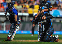 Daniel Vettori attempts a runout as Joe Root makes his ground during the ICC Cricket World Cup one day pool match between the New Zealand Black Caps and England at Wellington Regional Stadium, Wellington, New Zealand on Friday, 20 February 2015. Photo: Dave Lintott / lintottphoto.co.nz