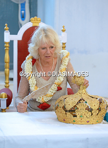 PRINCE CHARLES AND CAMILLA<br /> visit the Jewish Synagogue in Cochin, India_14/11/2013<br /> On the last day of their visit to India the Prince was honoured with the lighting of 65 candles on a  traditional Indian lamp to celebrate his 65th birthday.<br /> The Royal Couple also spent some time purchasing items including presents in the shops in Jew Street Market and Bazaar.<br /> Mandatory Credit Photo: &copy;Rooke/DIASIMAGES<br /> <br /> No UK Sales until 12/12 2013<br /> **ALL FEES PAYABLE TO: &quot;NEWSPIX INTERNATIONAL&quot;**<br /> <br /> IMMEDIATE CONFIRMATION OF USAGE REQUIRED:<br /> Newspix International, 31 Chinnery Hill, Bishop's Stortford, ENGLAND CM23 3PS<br /> Tel:+441279 324672  ; Fax: +441279656877<br /> Mobile:  07775681153<br /> e-mail: info@newspixinternational.co.uk