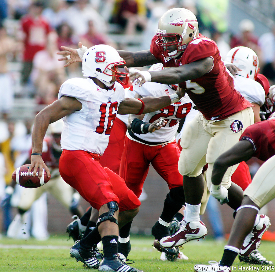 TALLAHASSEE, FL 10/31/09-FSU-NCST FB09 CH14-Florida State's Everett Dawkins flies in for the sack of N.C. State's Russell Wilson during first half action Saturday at Doak Campbell Stadium in Tallahassee. .COLIN HACKLEY PHOTO