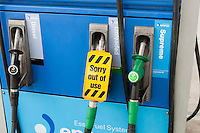 """""""Out of Use"""" sign on petrol pump."""