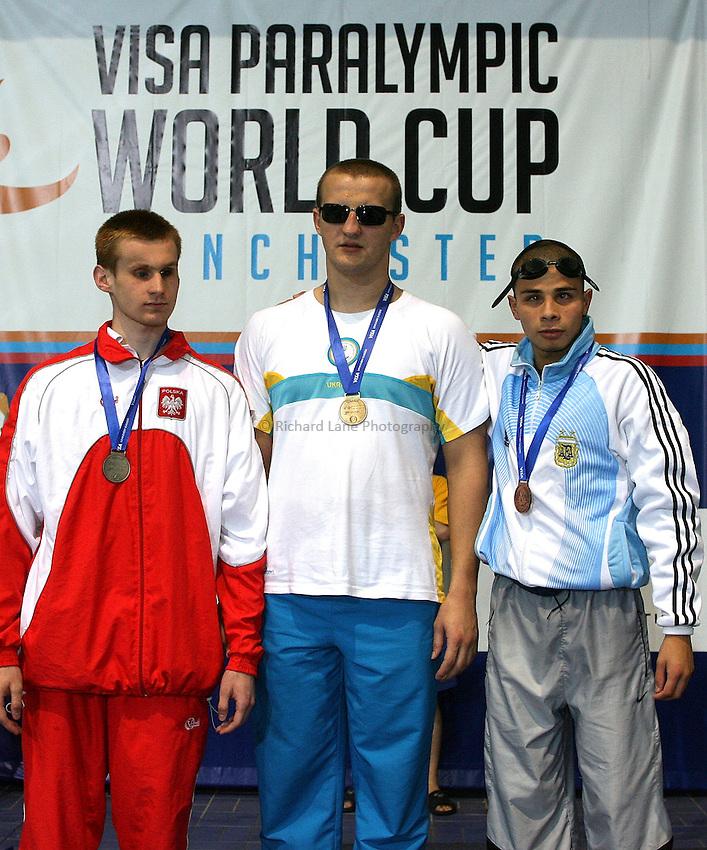 Photo: Paul Thomas..VISA Paralympic World Cup 2007. Swimming. 12/05/2007...Mens S11 100m Backstroke, (L-R) Damian Pietrasik of Poland, Viktor Smyrnv of Ukraine and Sergio Zayas of Argentina.