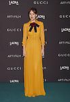 LOS ANGELES, CA - NOVEMBER 07: Actress Dakota Johnson, wearing Gucci attends LACMA 2015 Art+Film Gala Honoring James Turrell and Alejandro G Iñárritu, Presented by Gucci at LACMA on November 7, 2015 in Los Angeles, California.