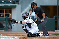 Charlotte Knights catcher Zack Collins (8) sets a target as home plate umpire Blake Carnahan looks on during the game against the Buffalo Bisons at BB&T BallPark on July 24, 2019 in Charlotte, North Carolina. The Bisons defeated the Knights 8-4. (Brian Westerholt/Four Seam Images)