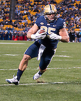 Pitt running back George Aston scores on a 4-yard touchdown catch. The Pitt Panthers football team defeated the Louisville Cardinals 45-34 on Saturday, November 21, 2015 at Heinz Field, Pittsburgh, Pennsylvania.