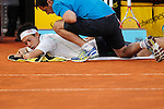 Japanese tennis player Kei Nishikori gets injured and retires during Madrid Open Tennis 2014 singles final match. May 11, 2014. (ALTERPHOTOS/Victor Blanco)