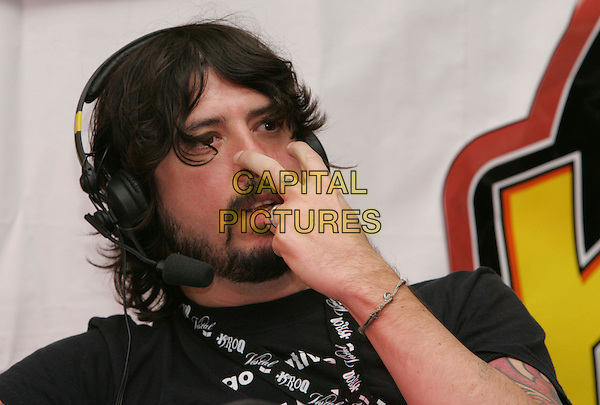 DAVE GROHL of  FOO FIGHTERS.backstage at Night one of The 106.7 KROQ Almost Acoustic Christmas held at The Gibson Ampitheatre in Universal City, California, USA, December 09 2006.portrait headshot headphones fingers eyes funny.CAP/DVS.©Debbie VanStory/Capital Pictures.