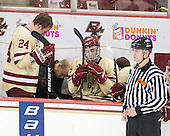 John Hegarty (BC - Dir-Hockey Ops) and Chris Malloy (BC - Manager) work on Bill Arnold's (BC - 24) helmet. - The Boston College Eagles defeated the visiting University of New Hampshire Wildcats 4-3 on Friday, January 27, 2012, in the first game of a back-to-back home and home at Kelley Rink/Conte Forum in Chestnut Hill, Massachusetts.