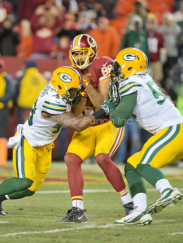 Washington Redskins tight end Jordan Reed (86) is tackled by Green Bay Packers linebacker Joe Thomas (48) and Packers outside linebacker Julius Peppers (56) in fourth quarter action in their NFC Wild Card game at FedEx Field in Landover, Maryland on Sunday, January 10, 2016.  The Packers won the game 35 - 18.<br /> Credit: Ron Sachs / CNP/MediaPunch ***FOR EDITORIAL USE ONLY***
