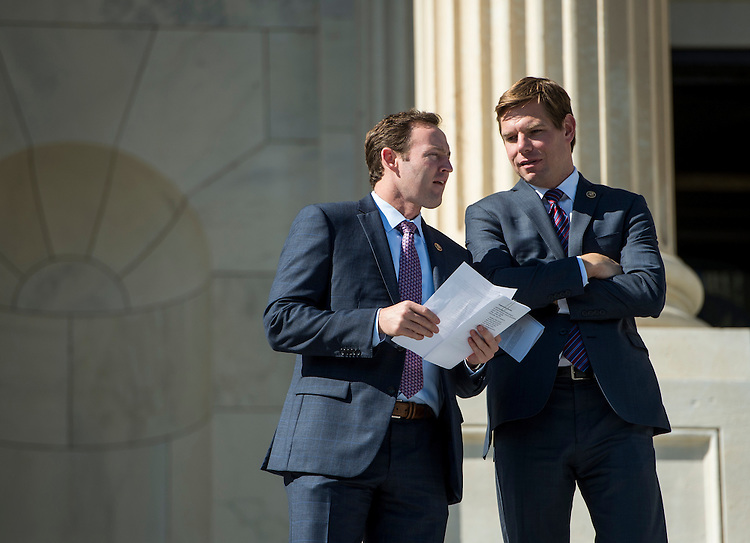 UNITED STATES - OCTOBER 23: Rep. Patrick Murphy, D-Fla., left, and Rep. Eric Swalwell, D-Calif., talk as they walk down the House steps following a vote in the Capitol on Friday, Oct. 23, 2015. (Photo By Bill Clark/CQ Roll Call)