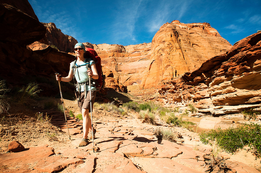 A hiker walks near the Paria River in northern Arizona.