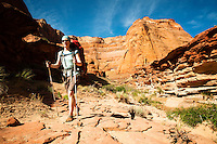 A hiker walks near the Paria River in northern Arizona.