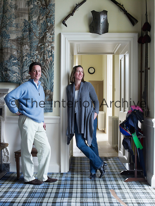 The Duke and Duchess of Argyll in the hall of the private wing of Inverary Castle