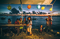 Children at a birthday party on the seafront. More than half of the island's inhabitants are children under 18 years of age.