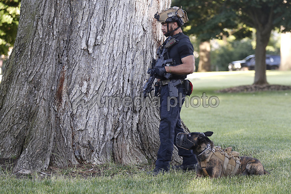 An armed agent with a K9 outside the White House before US President Donald J. Trump delivers remarks in the Rose Garden at the White House in Washington, DC, USA, 01 June 2020. Trump addressed the nationwide protests following the death of George Floyd in police custody.<br /> Credit: Shawn Thew / Pool via CNP/AdMedia