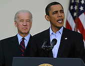 United States President Barack Obama makes a statement regarding the Iraqi parliamentary elections, as Vice President Joseph Biden listens, in the Rose Garden of the White House in Washington, DC, USA, Sunday, 07 March 2010.  Obama congratulated the Iraqi voters who were undeterred by violence, commended the government for security and mourned the lives lost by bombings at polling stations, which killed 36 people.          .Credit: Mike Theiler / Pool via CNP
