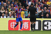 Wilfred Zaha of Crystal Palace argues with the ref before getting booked during Crystal Palace vs Brighton & Hove Albion, Premier League Football at Selhurst Park on 14th April 2018