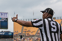 """A side judge appears to be giving the """"thumbs up"""" to Pitt. Iowa Hawkeyes defeated the Pitt Panthers 24-20 at Heinz Field, Pittsburgh Pennsylvania on September 20, 2014."""