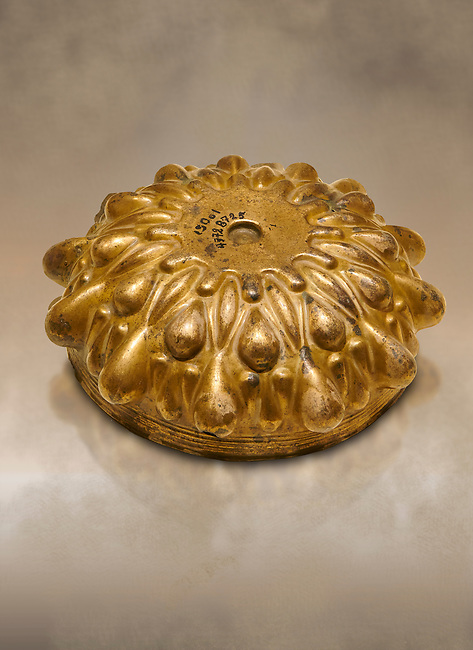Phrygian Gold bowl with deeply beated design from Gordion. Phrygian Collection, 8th-7th century BC - Museum of Anatolian Civilisations Ankara. Turkey. Against an art background