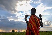 UGANDA Karamoja , Karimojong a pastoral tribe , young shepherd  / UGANDA Karamoja , Volk der Karimojong , Hirtenjunge
