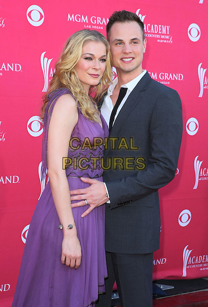 LeANN RIMES & DEAN SHEREMET.The 43rd Annual Academy of Country Music Awards (ACM) held at MGM Grand Garden Arena, Las Vegas, Nevada, USA..May 18th, 2008.half length purple dress grey gray suit married husband wife .CAP/ADM/MJT.© MJT/AdMedia/Capital Pictures.
