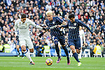 "Real Madrid's Raphael Varane and Malaga CF's Adalberto Peñaranda Maestre and Gonzalo ""Chory"" Castro during La Liga match between Real Madrid and Malaga CF at Santiago Bernabeu Stadium in Madrid, Spain. January 21, 2017. (ALTERPHOTOS/BorjaB.Hojas)"