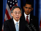 Chicago, IL - December 15, 2008 -- United States President-elect Barack Obama (R) istens to Nobel physics laureate Steven Chu (L) his nominee for energy secretary during a news conference in Chicago, Illinois on Monday, December 15, 2008. .Credit: Jeff Haynes / CNP