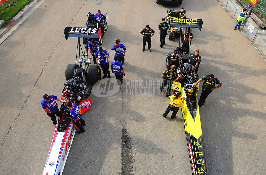 May 20, 2011; Topeka, KS, USA: NHRA top fuel dragster driver Morgan Lucas (right) and teammate Shawn Langdon sit in their cars in the staging lanes during qualifying for the Summer Nationals at Heartland Park Topeka. Mandatory Credit: Mark J. Rebilas-