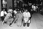 Protesters halted by National guard soldiers sit on sidewalk of Dexter Ave. during a series of protest marches from Black neighborhood toward State Capitol in Montgomery, Ala, photographed by Jim Peppler for essay in The Southern Courier published June 24, 1967. Copyright Jim Peppler/1967. This and over 10,000 other images are part of the Jim Peppler Collection at The Alabama Department of Archives and History:  http://digital.archives.alabama.gov/cdm4/peppler.php