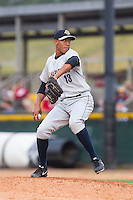 Charleston RiverDogs relief pitcher Angel Rincon (13) in action against the Hickory Crawdads at L.P. Frans Stadium on May 25, 2014 in Hickory, North Carolina.  The RiverDogs defeated the Crawdads 17-10.  (Brian Westerholt/Four Seam Images)