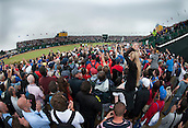 20.07.2014. Hoylake, England. The Open Golf Championship, Final Round. McIlroy and Fowler putt out for a 1-2 position on The 18th green.
