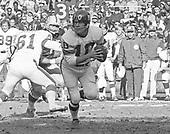 New York Giants quarterback Fran Tarkenton (10) looks for a receiver during the game against the Washington Redskins at RFK Stadium in Washington, DC on December 5, 1971. The Redskins won the game 23 - 7.<br /> Credit: Arnie Sachs / CNP