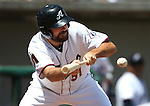 Reno Aces' Josh Collmenter bunts against the Iowa Cubs at Greater Nevada Field in Reno, Nev., on Tuesday, May 17, 2016. <br />