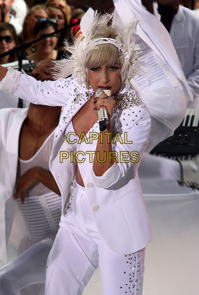 "LADY GAGA (Stefani Joanne Angelina Germanotta).performs live on NBC's the ""TODAY"" Show live from Rockefeller Center, New York, NY, USA, 9th July 2010..music on stage concert gig half length white pearls feather headdress hair band hairband head microphone singing suit bra hand claw trousers embellished jewel gem encrusted jacket suit .CAP/ADM/PZ.©Paul Zimmerman/AdMedia/Capital Pictures."